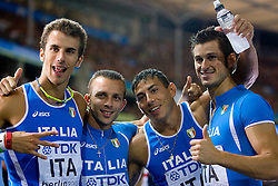 Italy's Fabio Cerutti, Emanuele Di Gregorio, Simone Collio and Roberto Donati celebrate after the men's 4x100m round 1 relay race of the 2009 IAAF Athletics World Championships on August 21, 2009 in Berlin. (Photo by Vid Ponikvar / Sportida)