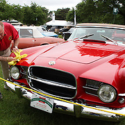 Ed Blumenthal cleans his 1957 Duel Ghia D-500 at the Greenwich Concours d'Elegance Festival of Speed and Style featuring great classic vintage cars. Roger Sherman Baldwin Park, Greenwich, Connecticut, USA.  2nd June 2012. Photo Tim Clayton
