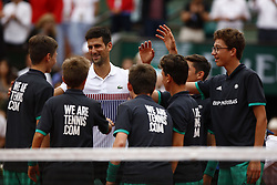 June 2, 2017 - Paris, France - Novak Djokovic (C) of Serbia celebrates with ball boys after he won the match against Diego Schwartzman (not seen) of Argentina in their third round match of the French Open tennis tournament at the Roland Garros stadium in Paris, France on June 02, 2017. (Credit Image: © Mehdi Taamallah/NurPhoto via ZUMA Press)