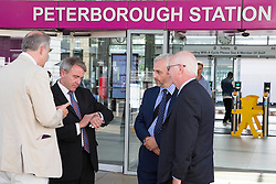 Image ©Licensed to i-Images Picture Agency. 04/07/2014. <br /> <br /> Under Secretary for transport  MP Robert Goodwill checks his watch after arriving late and his train being cancelled.<br /> <br /> MP Robert Goodwill arrives in Peterborough, with Ian Bates Cambs County Counciillor, Simon Machen Peterborough city Council and MP Stewart Jackso, after traveling the entire A47 from Gt Yarmouth to Peterborough.<br /> Picture by Terry Harris / i-Images