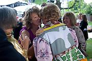 JULIA PEYTON-JONES; GRAYSON PERRY, 2009 Serpentine Gallery Summer party. Sponsored by Canvas TV. Serpentine Gallery Pavilion designed by Kazuyo Sejima and Ryue Nishizawa of SANAA. Kensington Gdns. London. 9 July 2009.