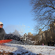 David Robin, 10, from New York sledding in Central Park after New York City was hit with over 7 inches of snow during its first winter storm of the year. Central Park, Manhattan, New York, USA. 4th January 2014 Photo Tim Clayton