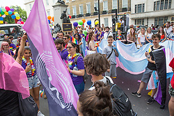 London, UK. 6 July, 2019. Participants in Pride in London show support for activists from Lesbians and Gays Support The Migrants, African Rainbow Family, the Outside Project, Micro Rainbow and other LGBT+ groups who stormed the Pride in London parade in solidarity with those for whom Pride in London is inaccessible and in protest against the corporatisation of Pride in London.