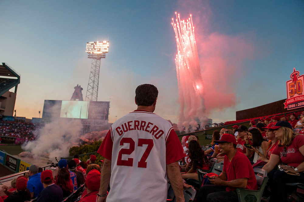 Andy Crowe, of Diamond Bar, watches the fireworks in center field before the Angels' home opener Monday at Angel Stadium.<br /> <br /> ///ADDITIONAL INFO:   <br /> <br /> angels.0405.kjs  ---  Photo by KEVIN SULLIVAN / Orange County Register  --  4/4/16<br /> <br /> The Los Angeles Angels take on the Chicago Cubs during their 2016 home opener Monday at Angel Stadium.<br /> <br /> <br />  4/4/16