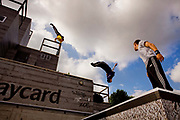 The UK's best parkour and freerunning athletes performing on a purpose-built rig.<br /> Thames Festival 08, Jubilee Gardens, along the southbank of the Thames. September 2008.