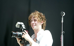 Johnny Borrell, the lead singer and rhythm guitarist of the band Razorlight, on the main stage on Sunday 10th July, 2005 at the two-day T in the Park festival, at Balado, Kinross-shire, Scotland..