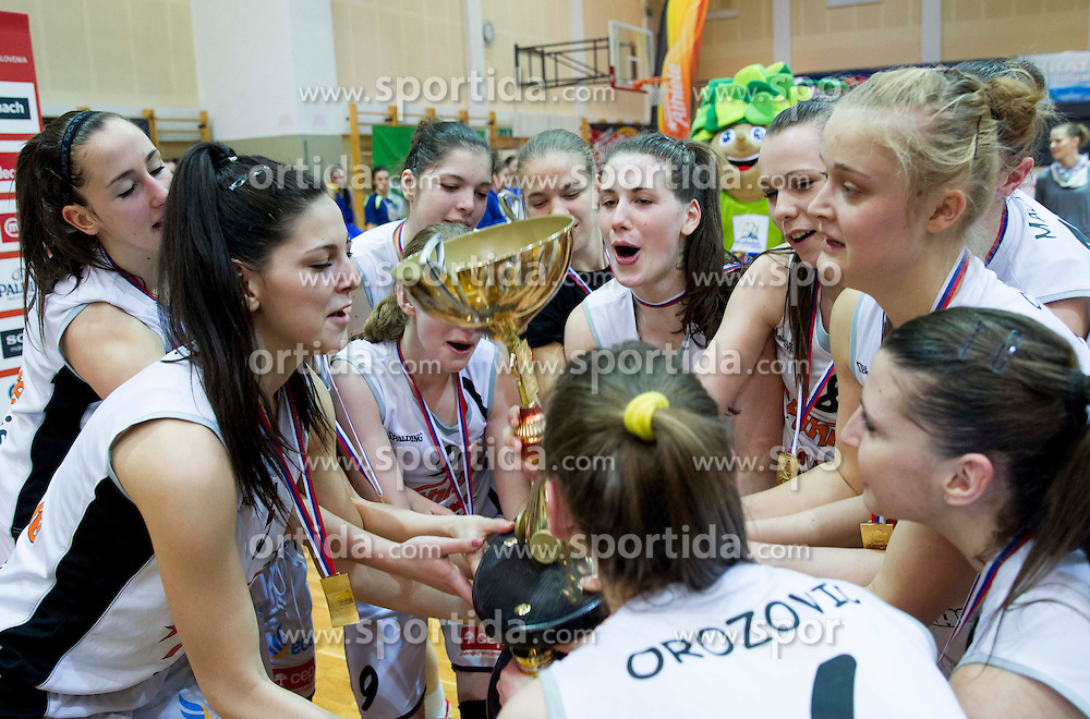 Players of Celje celebrate after winning the basketball match between ZKK Athlete Celje and ZKK Domzale in final of Slovenian Women Basketball Cup 2013, on March 3, 2013 in Celje, Slovenia.  Celje defeated Domzale 79-59 and became Slovenian Cup Champion 2013. (Photo By Vid Ponikvar / Sportida)
