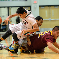 011315  Adron Gardner/Independent<br /> <br /> Wingate Bears Brandon Badonie (20), left, and Joshua Holiday (23) collide with Tohatchi Cougar Jaden Dolfin (32) at Wingate High School Tuesday.