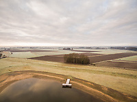 Aerial view of single wooden pier over a calm lake, Netherlands.