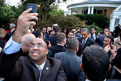 A guest takes a selfie as President Barack Obama greets attendees during a reception hosted by Vice President Joe Biden and Dr. Jill Biden in honor of Hispanic Heritage Month, at the Vice President's Residence at the Naval Observatory in Washington, D.C., Sept. 22, 2014. (Official White House Photo by Pete Souza)<br /> <br /> This official White House photograph is being made available only for publication by news organizations and/or for personal use printing by the subject(s) of the photograph. The photograph may not be manipulated in any way and may not be used in commercial or political materials, advertisements, emails, products, promotions that in any way suggests approval or endorsement of the President, the First Family, or the White House.