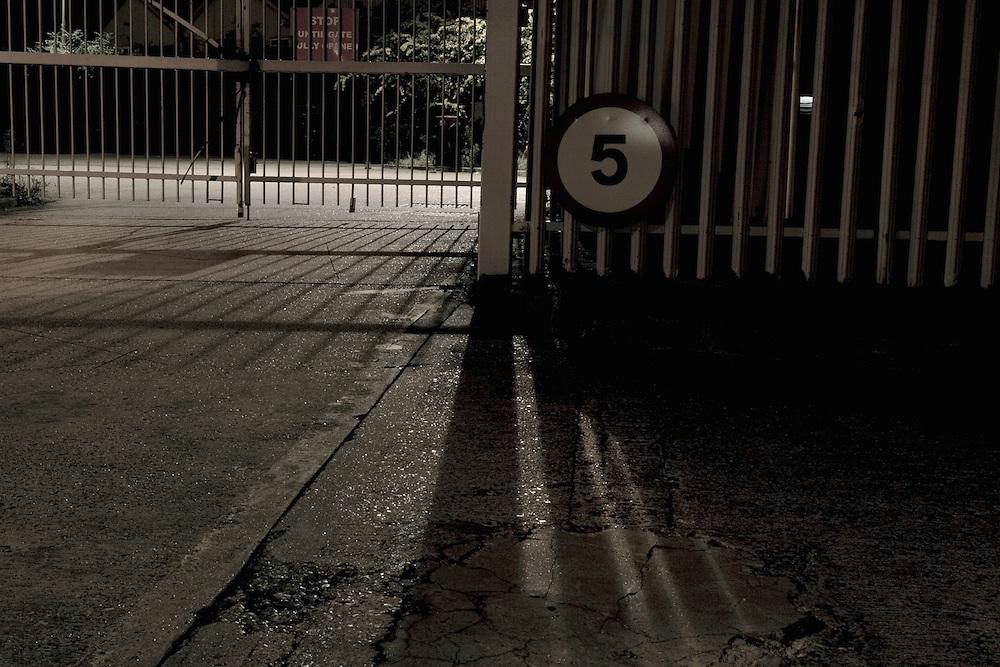 Closed Gate - Urban Landscape at Night