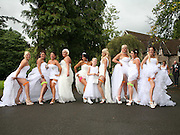 """This gay couple invited 10 brides to their wedding so their big day wouldn't be missing a big white dress<br /> <br /> <br /> A gay couple ended up inviting 10 """"brides"""" to their wedding so that the pictures from the big day wouldn't be missing a fabulous white dress.<br /> Grooms Deri Rogers, 28, and partner Ben Wood, 25, had their 10 bridesmaids all dressed up in big white gowns - to look fantastic in their wedding picture album.<br /> And the happy Welsh couple have so many girly friends that they couldn't limit their bridesmaids to just two or three.<br /> So they had the girls each pick their favourite wedding dress to wear to their ceremony.<br /> Happy husband Deri said: """"We had lots of ideas for the wedding from the girls - but I wanted something outrageous.<br /> """"Being a gay wedding we weren't going to have an amazing gown reveal like at other big weddings.<br /> """"I figured every wedding needs a wedding dress - so why not 10?<br /> """"The girls all have huge personalities and so there was terrible competition, dress disasters and fall outs but on the day they all looked fab.<br /> Read more: Couple tie the knot after 10 years<br /> """"You could say the girls stole the lime light but we wouldn't have had it any other way.""""<br /> Each bridesmaid sourced a unique dress from eBay or online boutiques for the ceremony at the Cwrt Bleddyn Hotel, near Usk.<br /> Deri and Ben's best """"man"""" Sadie spent £500 on a strapless diamante encrusted bridal gown to be belle of the ball.<br /> It was Sadie who first introduced the couple in 2013.<br /> Deri, of Cwmbran, said: """"We went on a first date but nothing really came of it.<br /> Read more: 'Everything was perfect, it was like a dream!'<br /> """"It was only months later that we got back in touch and then in January this year Ben proposed.""""<br /> The couple - who both work together managing a country pub - also hired an LED dancefloor, a chocolate fountain, a candy floss cart, three photographers and bought a £400 cake for their"""