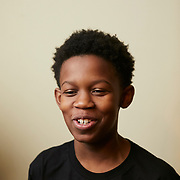 """CHARLOTTE, NC - DECEMBER 14: Ajani Dartiguenave, a 12 year old student at Governors' Village STEM Academy, sits in his families play room inside their home in Charlotte, NC on Friday December 14, 2018. During a recent lockdown at his school he wrote his mother a """"Good Bye"""" letter because he was scared that a gunman was going to come and do harm to him and his class. Since then, Ajani was given a smart phone to have with him at all times.  (Photo by Logan Cyrus for The Washington Post)"""