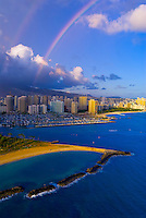 Aerial view of the Ala Wai Yacht Harbor (with Magic Island in foreground) with Waikiki behind and a rainbow overhead, Honolulu, Oahu, Hawaii, USA