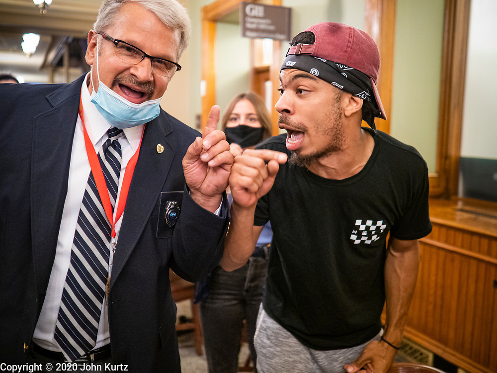 19 JUNE 2020 - DES MOINES, IOWA: MATTHEW BRUCE, from Des Moines (right), argues with a member of the Capitol security staff during a Black Lives Matter Juneteenth rally in the Iowa State Capitol. About 100 supporters of Des Moines Black Lives Matter finished their week long series of protests at the Iowa State Capitol with a Juneteenth rally and demonstration. They are demanding that Gov. Kim Reynolds use an executive order to restore voting rights to felons who have completed their sentences. The protesters did not meet with the Governor Friday. The protest was peaceful.       PHOTO BY JACK KURTZ