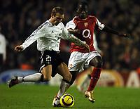 Photo: Javier Garcia/Back Page Images Mobile +447887 794393 Arsenal v Rosenborg, UEFA Champions League 07/12/04, Highbury<br />Quincy Owusu-Abeyie puts pressure on Stale Stensaas