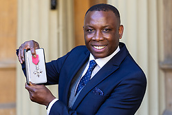 Leroy Rosenior, Vice President, Show Racism The Red Card proudly displays his MBE for services to Tackling Discrimination in Sport following an investiture ceremony at Buckingham Palace in London. London, March 14 2019.