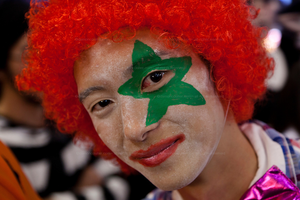 A young man dressed in a clown costume to celebrate Halloween in Shibuya, Tokyo, Japan. Thursday, October 31st 2013