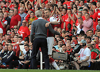 Football - 2017 / 2018 Premier League - Arsenal vs. Burnley<br /> <br /> Per Mertesacker of Arsenal embraces Arsene Wenger as he comes on for the last time as a substitute at The Emirates.<br /> <br /> COLORSPORT/ANDREW COWIE