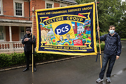 London, UK. 30th July, 2021. Members of the PCS Culture Group hold a banner at a picket by Royal Parks workers outsourced via French multinational VINCI Facilities outside the Old Police House in Hyde Park as part of joint strike action by the United Voices of the World (UVW) and Public and Commercial Services (PCS) trade unions. The joint strike, with members dual carding over pay, conditions and the sacking of a member of staff, is believed to be the first between a TUC and a non-TUC trade union and follows the launch of a legal challenge by the Royal Parks workers against indirect racial discrimination by the Royal Parks.