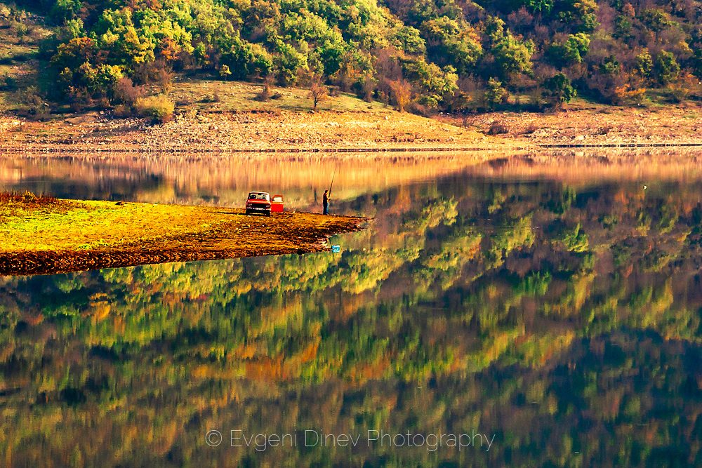 Scenery colorful lake in autumn palette