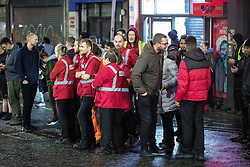 © Licensed to London News Pictures. 18/10/2019. Manchester, UK. Evacuated staff wait on Withy Grove . Armed police and paramedics respond and the Arndale Centre and surrounding streets in Manchester City Centre are evacuated after reports of a man armed with a knife in the shopping centre . Photo credit: Joel Goodman/LNP