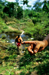 Indigenous man showing oil that has come from the contaminated water supply
