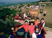 The Castillo Balderas family of Guadalajara, Mexico, outside their home with all of their possessions. Published in Material World: A Global Family Portrait, pages 144-145. From Peter Menzel's Material World Project that showed 30 statistically average families in 30 countries with all of their possessions.