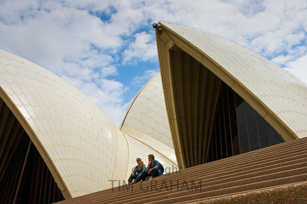 Tourists sit on the steps infront of the Sydney Opera House, Australia