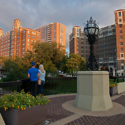 A couple standing in the area of the Country Club Plaza in Kansas City, Missouri.
