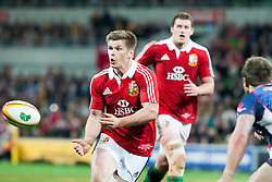 © Licensed to London News Pictures. 25/6/2013. Owen Farrell passes the ball during the British & irish Lions tour match between Melbourne Rebels Vs British & Irish Lions at AAMI Park, Melbourne, Australia. Photo credit : Asanka Brendon Ratnayake/LNP