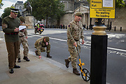 According to protocol, members of the Coldstream Guards, led by 'H. M. Ceremonial Warrant Officer WO1 (GSM) Andrew 'Vern' Stokes, mark in chalk the route along Whitehall for a future ceremony, on 5th October, 2017, in London, England.