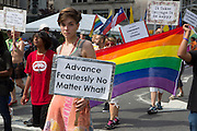 """A woman with a contingent of Buddhists caries a placard reading """"Advance fearlessly no matter what!"""""""
