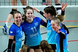 Team Zwolle celebrate with Marly Bak of Zwolle, Sanne Konijnenberg of Zwolle, Nynke Hofstede of Zwolle before the first league match between Djopzz Regio Zwolle Volleybal - Laudame Financials VCN on February 27, 2021 in Zwolle.