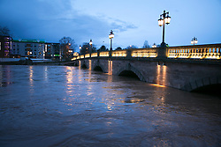 © Licensed to London News Pictures. 13/2/2014. Worcester, UK. The River Severn flowing through Worcester reaches an all time high. Pictured, the river severn flows under the main bridge in Worcester as dawn breaks. Photo credit : Dave Warren/LNP