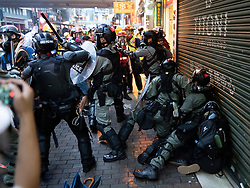 Hong Kong. 6 October 2019. Tens of thousands of pro-democracy protestors march in pouring rain through centre of Hong Kong today from Causeway Bay to Central. Peaceful march later turned violent as a hard-core of protestors confronted police. Pic; Police come under attack from protestors in Causeway Bay.  Iain Masterton/Alamy Live News.