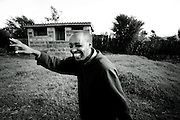 """LIMURU, KENYA – MARCH 13, 2010: Fredeick Chege Gichere is the resident caretaker, watchman and farmer at a local church. Gichere contracted HIV in 1999 after his wife left with their baby girl. """"When you have tested positive in Kenya, most people think that is the end of you. So I thought life had come to an end, but it was not the end. I have seen God working wonders in my life."""" In 2008, Gichere began receiving assistance from CARE for AIDS, an nonprofit dedicated to caring for the physical and spiritual needs of families affected by HIV/AIDS in Kenya. Through the assistance, Gichere was equipped with the farming and agricultural skills he needed to begin raising various vegetables at the church compound where he works."""