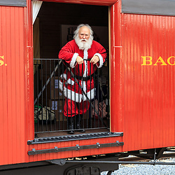 Strasburg, PA USA - December 20, 2014:  Santa arrives in a raildroad car at the Strasburg Rail Road, Lancaster County.