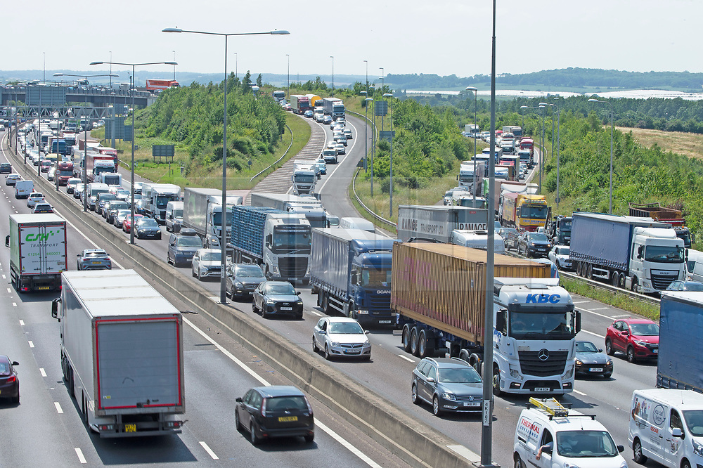 © Licensed to London News Pictures 23/07/2021. Dartford, UK. Bumper to Bumper getaway traffic queueing for miles on the M25 in Kent towards the Dartford Crossing. As the heatwave weather continues today in the UK thousands of motorists head off for their family summer getaway. Photo credit:LNP