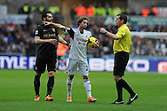 Jose Canas of Swansea city has words with referee Phil Dowd which leads to him getting a booking.Barclays Premier league, Swansea city v Manchester City at the Liberty Stadium in Swansea,  South Wales on  New years day Wed 1st Jan 2014 <br /> pic by Andrew Orchard, Andrew Orchard sports photography.
