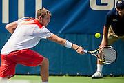 USA's Jack Sock hits a return to Japan's Kei Nishikori during their men's singles match at the Citi Open ATP tennis tournament in Washington, DC, USA, 1 Aug 2013. Nishikori won the match 7-5, 6-2 to advance.
