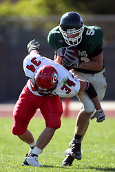 04 October 2008: Dan Rogers gets position on Jake Smith and intercepts a pass thrown by Evan Jones in a battle between the Carthage Red Men and the Illinois Wesleyan University Titans, Game action was at Wilder Field on the campus of Illinois Wesleyan University in Bloomington Illinois.