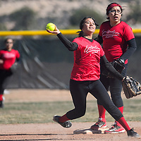 032515       Cable Hoover<br /> <br /> St. Michael Cardinal shortstop Chrissa Duncan (22) throws to first to stop a Window Rock Scout runner Wednesday at Window Rock High School.