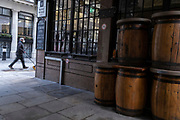 Wooden barrels that normally serve as drinks tables remain stacked outside the closed 'Bunch of Grapes' pub on Beehive Passage during the third lockdown of the Coronavirus pandemic, in the 'City of London', the capital's financial district, aka The Square Mile, on 2nd February 2021, in London, England.