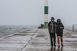 © Licensed to London News Pictures. 18/08/2017. Aberystwyth, UK. The disappointing 2017 summer continues in its unsettled form, with gale force winds and storms bringing huge waves crashing into the sea defences in  Aberystwyth Wales on the west coast of wales.  More unseasonal stormy weather is forecast for Sunday, as the tail end of tropical storm Gert hits Britain. Photo credit: Keith Morris/LNP