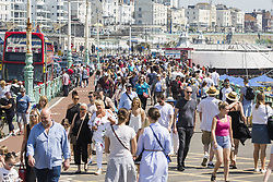 May 6, 2018 - Brighton, East Sussex, United Kingdom - Brighton, UK. Thousands of people take to the beach in Brighton and Hove on the May Bank Holiday Sunday as warm weather continues to hit the seaside resort. This weekend has been the hottest May Bank Holiday in the last 40 years. (Credit Image: © Hugo Michiels/London News Pictures via ZUMA Wire)