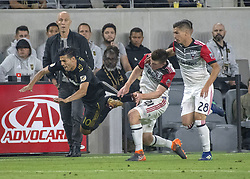 May 26, 2018 - Los Angeles, California, U.S - LAFC's Carlos Vela (10) goes flying past DC United's Chris Durkin (21) and DC United's Joseph Mora (28) during the second half of the match between Los Angeles Football Club and DC United at the Banc of California Stadium on Saturday, May 26, 2018. (Credit Image: © Michael Goulding via ZUMA Wire)