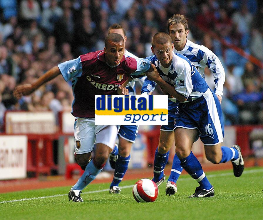 Photo: Dave Linney.<br />Aston Villa v Reading. The Barclays Premiership. 23/08/2006Aston Villa's .Gabriel Agbonlahor(L)  holds off the challenge from Ivar Ingimarsson