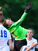 Althoff goalkeeper Anna Werner leaps for a corner kick. Althoff played Columbia in the sectional championship game at Althoff High School in Belleville, IL on Friday June 11, 2021. <br /> Tim Vizer/Special to STLhighschoolsports.com.