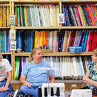 072114  Adron Gardner/Independent<br /> <br /> Lynn Olinger, led,t Jeannie Kamps and Lisa Byker, a mother of four kids who has been diagnosed with a brain tumor share stories at the Gallup Service Mart in Gallup Monday.